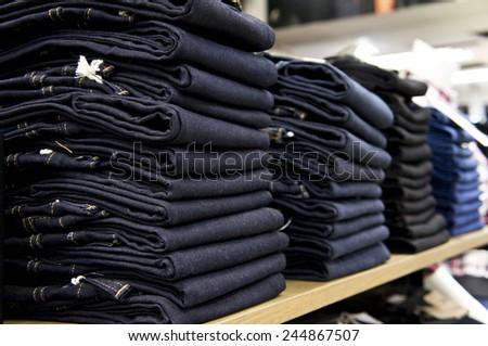 jeans on shelf in shop - stock photo