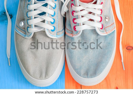 Jeans sports shoes  - stock photo