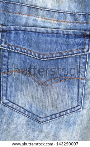Jeans texture. Hip pocket. Close-up. Whole background. - stock photo