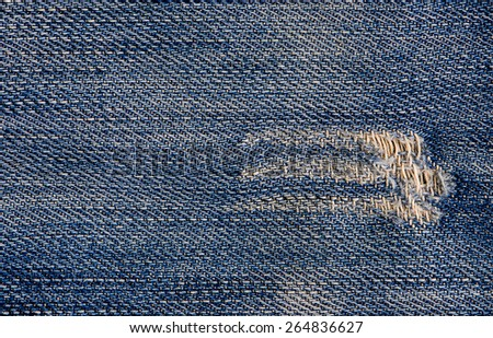 Jeans texture or background denim blue with tear. - stock photo