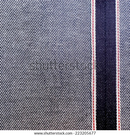 Jeans texture with red seams - stock photo