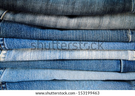 Jeans trousers stack closeup. - stock photo