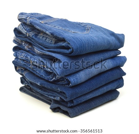 Jeans trousers stack on white background - stock photo