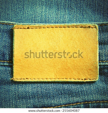 Jeans with blank leather label. Retro style filtred image - stock photo