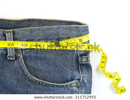 jeans with centimeter in weight loss concept - stock photo