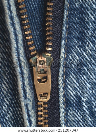 Jeans with golden color copper zipper close up        - stock photo