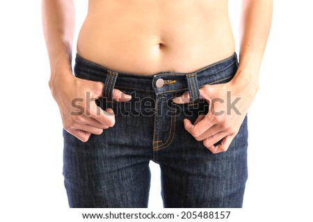Jeans, Woman waist wearing jeans. Weight loss stomach closeup. Skinny jeans on a healthy slim fit body. - stock photo