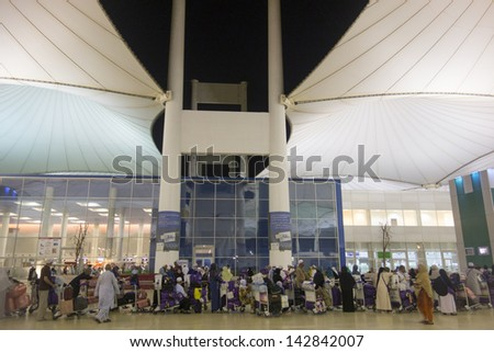 JEDDAH,SAUDI ARABIA-JUNE 9:Pilgrims at Jeddah Hajj International Airport in Jeddah on June 9, 2013. The airport which cater for hajj pilgrims during hajj season is the busiest airport of Saudi Arabia. - stock photo