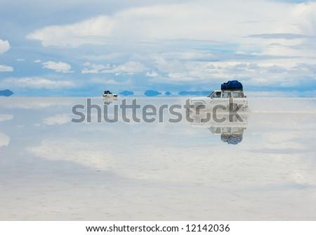jeep in the salt lake salar de uyuni, bolivia - stock photo