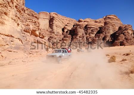 jeep safari in a desert in Jordan - stock photo