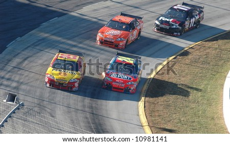 Jeff Gordon,Kevin Harvick,Tony Stewart & Denny Hamlin racing hard during the NASCAR race at Martinsville Va. - stock photo