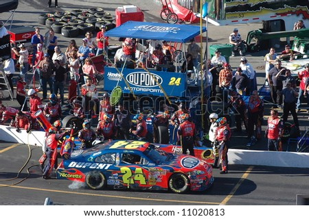 Jeff Gordon making a pit stop during the NASCAR race at Martinsville Va. - stock photo
