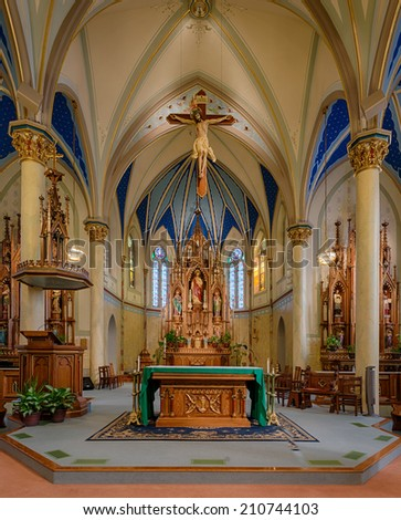JEFFERSON CITY, MISSOURI - JULY 21: Altar and sanctuary of the St. Peter Catholic Church on July 21, 2014 in Jefferson City, Missouri - stock photo