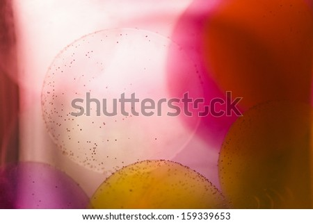 Jelly balls in water with ink  - stock photo