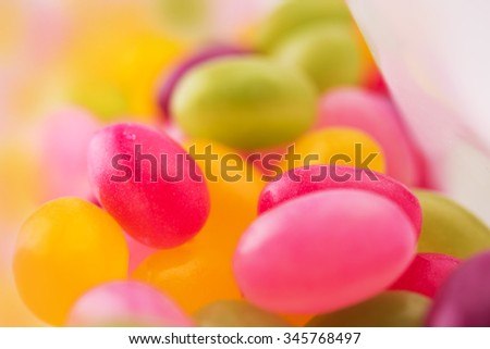 Jelly beans or sugar coated gummy candy inside a plastic bag. Extremely shallow depth of field. - stock photo