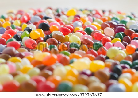 Jelly beans sideview background with selective focus - stock photo
