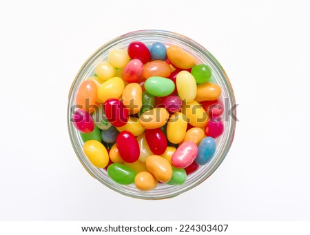Jelly beans with a glass jar - stock photo