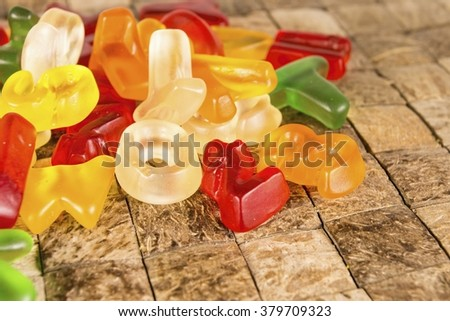 Jelly candies on wooden background. Macro shot. - stock photo