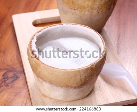 Jelly coconut thai food on wooden table surface  - stock photo