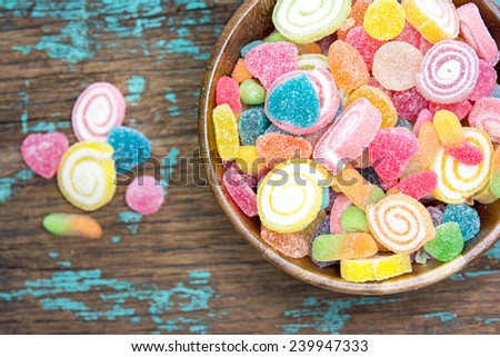 jelly stars in bowl on wooden table  - stock photo