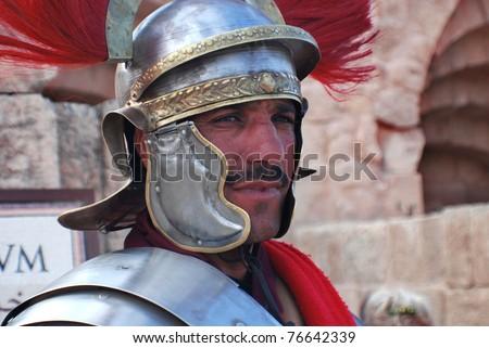 JERASH - NOVEMBER 25: An unidentified Jordanian man dresses as Roman soldier during a roman army reenactment show on November 25, 2009 in Jerash, Jordan - stock photo