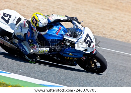 JEREZ DE LA FRONTERA, SPAIN - APR 17: Stock Extreme motorcyclist Ferran Casas takes a curve in the CEV Championship race on April 17, 2011 in Jerez de la Frontera, Spain - stock photo