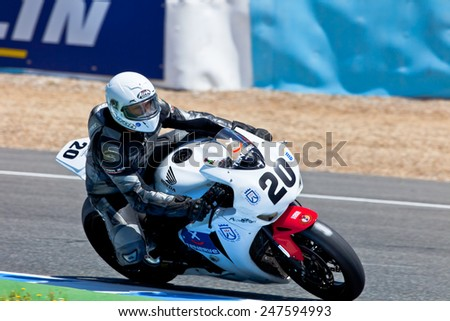 JEREZ DE LA FRONTERA, SPAIN - APR 17: Stock Extreme motorcyclist Juan Alonso takes a curve in the CEV Championship race on April 17, 2011 in Jerez de la Frontera, Spain - stock photo