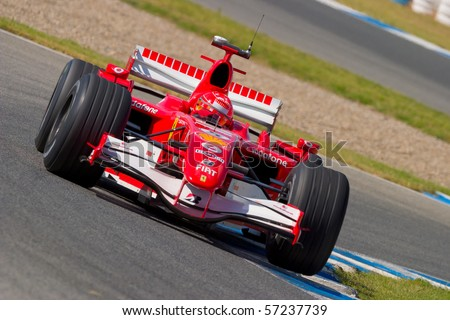 JEREZ DE LA FRONTERA, SPAIN - CIRCA 2006 : Michael Schumacher of Scuderia Ferrari F1 on training session circa 2006 in Jerez de la Frontera, Spain. - stock photo