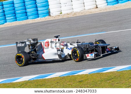 JEREZ DE LA FRONTERA, SPAIN - FEB 10: Kamui Kobayashi of Sauber F1 races on training session on February 10 , 2012, in Jerez de la Frontera , Spain - stock photo