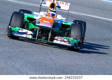 JEREZ DE LA FRONTERA, SPAIN - FEB 10: Nico H���¼lkenberg of Force India F1 races on training session on February 10 , 2012, in Jerez de la Frontera , Spain - stock photo