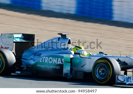 JEREZ DE LA FRONTERA, SPAIN - FEB 09: Nico Rosberg of Mercedes-AMG team drives his F1 car during training session at Jerez circuit on February 09, 2012, in Jerez de la Frontera , Spain - stock photo