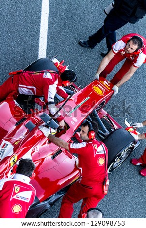 JEREZ DE LA FRONTERA, SPAIN - FEB 08: Pedro Martinez de la Rosa of Scuderia Ferrari F1 entering to the pit on training session on February 08 , 2013, in Jerez de la Frontera , Spain - stock photo