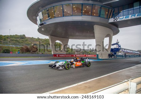 JEREZ DE LA FRONTERA, SPAIN - JAN 31: Daniel Juncadella of Force India F1 leaving the pit on training session on January 31 , 2014, in Jerez de la Frontera , Spain - stock photo