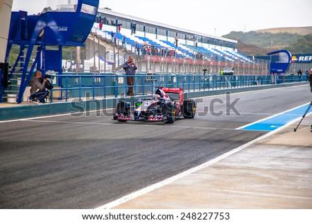 JEREZ DE LA FRONTERA, SPAIN - JAN 31: Daniil Kvyat of Scuderia Toro Rosso F1 leaving the pit on training session on January 31 , 2014, in Jerez de la Frontera , Spain - stock photo