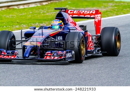 JEREZ DE LA FRONTERA, SPAIN - JAN 28:  Jean-Eric Vergne of Toro Rosso F1 races on training session on January 28 , 2014, in Jerez de la Frontera , Spain - stock photo