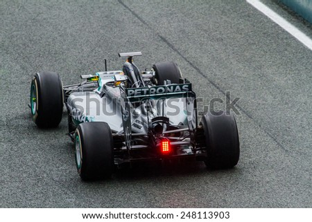 JEREZ DE LA FRONTERA, SPAIN - JAN 31: Lewis Hamilton of Mercedes AMG Petronas F1 leaving the pit on training session on January 31 , 2014, in Jerez de la Frontera , Spain - stock photo