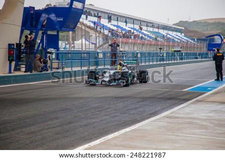 JEREZ DE LA FRONTERA, SPAIN - JAN 31: Nico Rosberg of Mercedes AMG Petronas F1 leaving the pit on training session on January 31 , 2014, in Jerez de la Frontera, Spain - stock photo