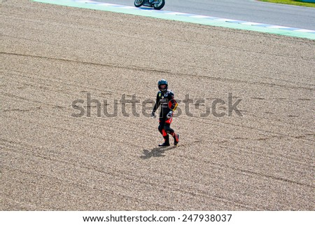 JEREZ DE LA FRONTERA, SPAIN-MAR 5: 125cc motorcyclist Daniel Kartheininge after an accident on the official training of the world championship of MotoGP on March 5, 2011 in Jerez de la Frontera, Spain - stock photo