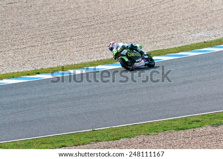 JEREZ DE LA FRONTERA, SPAIN - MAR 5: Moto2 motorcyclist Hector Faubel takes a curve in the MotoGP Official Trainnig on Mar 5, 2011 in Jerez de la Frontera, Spain - stock photo