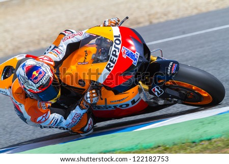 JEREZ DE LA FRONTERA, SPAIN - MAR 23: MotoGP motorcyclist Casey Stoner takes a curve in the MotoGP Official Trainnig on March 23, 2012 in Jerez de la Frontera, Spain - stock photo