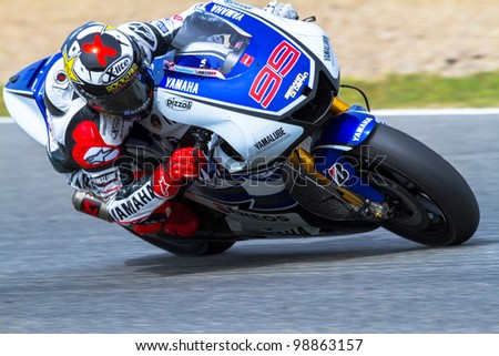 JEREZ DE LA FRONTERA, SPAIN - MAR 25: MotoGP motorcyclist Jorge Lorenzo takes a curve in the MotoGP Official Trainnig on March 25, 2012 in Jerez de la Frontera, Spain - stock photo