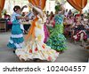JEREZ DE LA FRONTERA, SPAIN-MAY 12:Women in traditional flamenco dancing during the show the horse the day May 12, 2012, in Jerez de la Frontera, Spain - stock photo