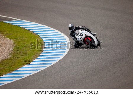 JEREZ DE LA FRONTERA, SPAIN - NOV 20: Stock Extreme motorcyclist Juan Alonso takes a curve in the CEV championship on Nov 20, 2010, in Jerez de la Frontera, Spain - stock photo