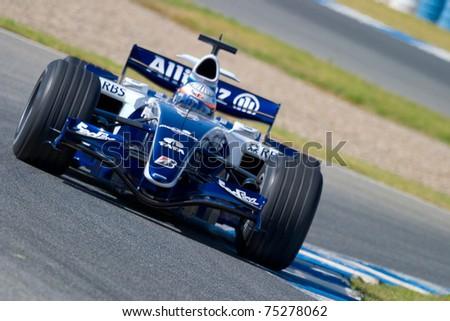 JEREZ DE LA FRONTERA, SPAIN -  OCT 11: Narain Karthikeyan of Williams F1 races in training session on October 11, 2006 in Jerez de la Frontera, Spain - stock photo