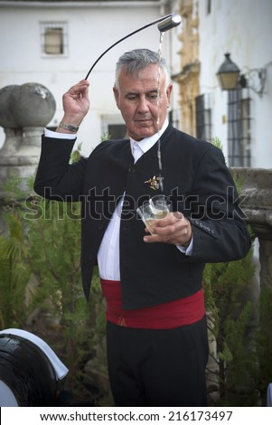 JEREZ DE LA FRONTERA, SPAIN-SEPTEMBER 10: Venenciador of during inaugural ceremony of the festival of the harvest  on sep 10, 2014 in Jerez de la frontera.  - stock photo
