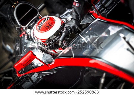 JEREZ, SPAIN - FEBRUARY 2ND: Jenson Button testing his new Mclaren Honda MP4-30 F1 car on the first Test at the Jerez Circuit in Jerez, Andalucia, Spain on Feb. 2, 2015. - stock photo