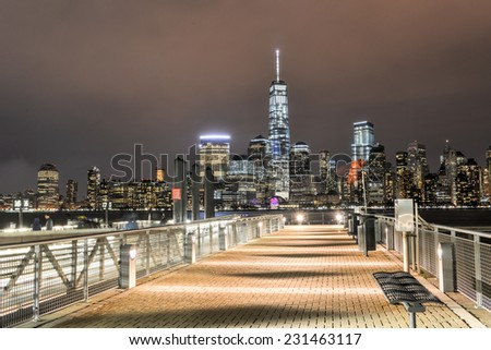 JERSEY CITY, NEW JERSEY - NOVEMBER 8, 2014: New York City Manhattan skyline over Hudson River viewed from New Jersey piers - stock photo