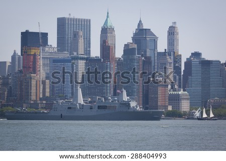 JERSEY CITY, NJ - MAY 26 2015: USS San Antonio (LPD 17) passes Lower Manhattan on the Upper New York Bay after departing Pier 92 at the end of Fleet Week NY 2015. - stock photo