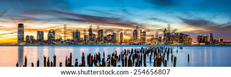Jersey City panorama at sunset as viewed from Tribeca, New York across the Hudson River - stock photo