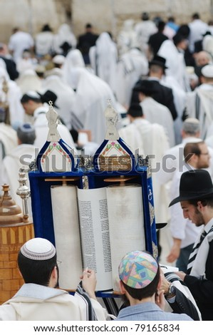 JERUSALEM - APRIL 26: Jewish prayers and pilgrims beside Western Wall during Jewish holiday of Passover on April 26, 2007 in Jerusalem, Israel. - stock photo